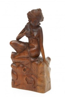 a-balinese-carved-wood-sculpture-of-a-kneeling-woman-1.jpg